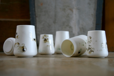 'OPGEROLD' CUPS & CARAFE